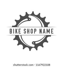 Bikes Shop Emblem. Design Element for Bike Shop or Advertising Banner. Chainring and Place for Your Bike Shop Name, Monochrome Vector Illustration.