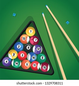 Billiard cue and pool balls in triangle on green table while game. Biliard balls, triangle and pool stick for game on green table top view