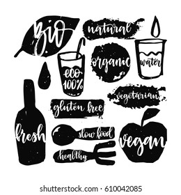 Bio set calligraphic hand written with brush pen. Organic logos and emblems and healthy food signs.