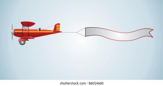 Biplane aircraft pulling advertisement banner
