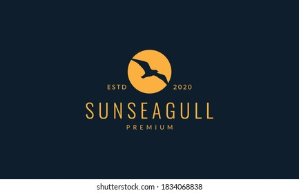 bird seagull fly on sunset logo vector illustration design