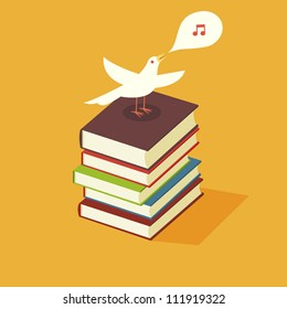 Bird singing perched on stack of books