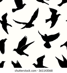 Birds silhouettes - flying seamless pattern. Black and white.