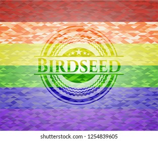 Birdseed emblem on mosaic background with the colors of the LGBT flag