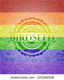 Birdseed on mosaic background with the colors of the LGBT flag