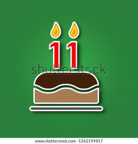 Birthday Cake With A Candle In The Form Of Number 11