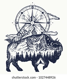 Bison double exposure, mountains, compass, tattoo art. Buffalo silhouette t-shirt design. Tourism symbol, adventure, great outdoor