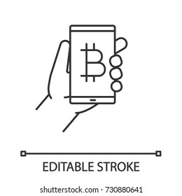 Bitcoin digital wallet linear icon. Thin line illustration. Cryptocurrency. Hand holding smartphone with bitcoin sign. Contour symbol. Vector isolated outline drawing. Editable stroke