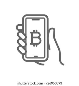 Bitcoin online symbol on the smartphone in hand line icon. Cryptocurrency bitcoin online wallet concept. Linear vector icon isolated on white transparent background.