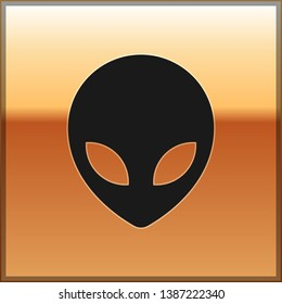 Black Alien icon isolated on gold background. Extraterrestrial alien face or head symbol. Vector Illustration