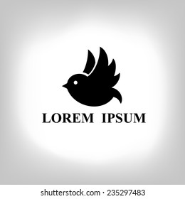 Black bird isolated with expanded wings. Logo design for company.