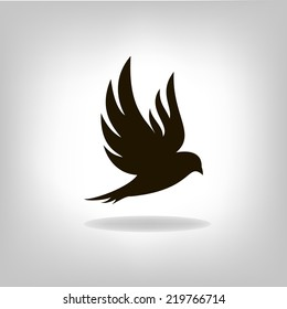Black bird isolated with outstretched wings. Logo design for company.