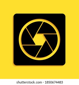 Black Camera shutter icon isolated on yellow background. Long shadow style. Vector.