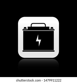 Black Car battery icon isolated on black background. Accumulator battery energy power and electricity accumulator battery with Lightning bolt. Square button vector Illustration