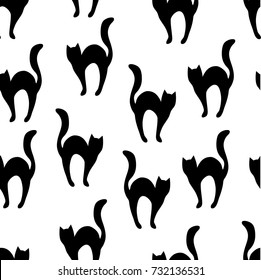 Black cats silhouettes, seamless pattern. Halloween design.