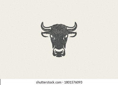 Black cow head silhouette with horns designed for meat industry hand drawn stamp effect vector illustration. Vintage grunge texture emblem for butchery packaging and menu design or label decoration.
