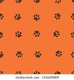 Black doodle paw prints with orange background seamless pattern. Happy Halloween background