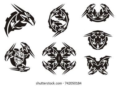 Black dragon head symbols in tribal style. Peaked twirled dragon head symbols for a tattoo, vinyl cutting and another