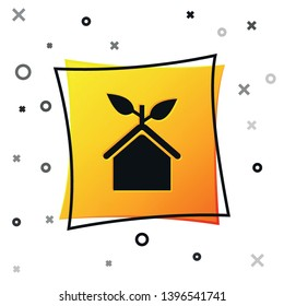 Black Eco friendly house icon isolated on white background. Eco house with leaf. Yellow square button. Vector Illustration