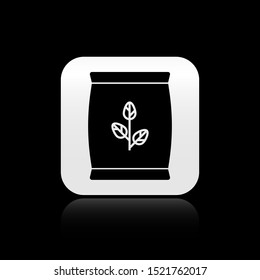 Black Fertilizer bag icon isolated on black background. Silver square button. Vector Illustration