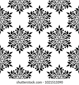 Black floral ornament on white background. Seamless pattern for textile and wallpapers