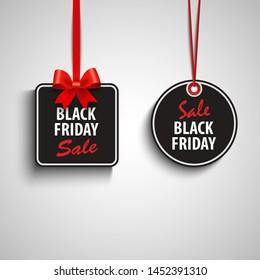 Black friday sale tags in dark design
