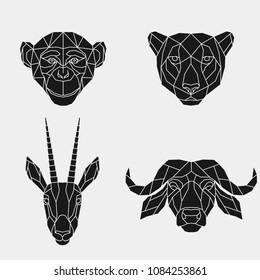 The black geometric heads of a monkey, cheetah, antelope and buffalo. Set polygonal abstract animals of Africa. Vector illustration.