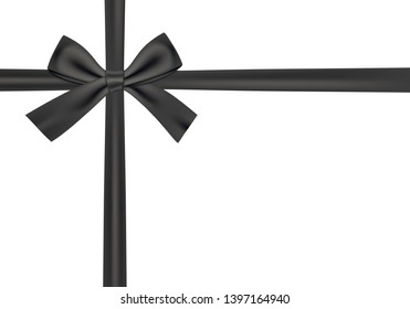 Black gift ribbon and bow on white background.