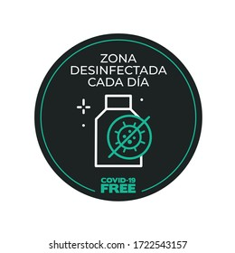 Black and green round sticker for disinfected areas of coronavirus. Covid-19 free. Disinfected area every day written in Spanish