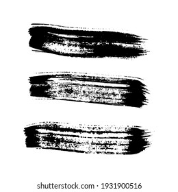 Black grunge brush strokes. Set of three painted ink stripes. Ink spot isolated on white background. Vector illustration