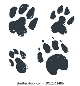 Black hand drawn isolated wild animal footprints. Grunge ink illustration. Vector collection. Dogs trace