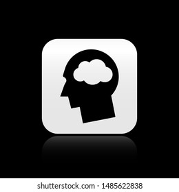 Black Head silhouette with cloud icon isolated on black background. Dreaming sign. Silver square button. Vector Illustration