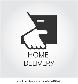 Black icon of hand holding parcel in flat style. Home delivery, fast and convenient service concept logo for websites, mobile apps and other design needs. Vector illustation