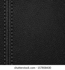 black leather background with white stitching