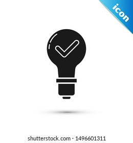 Black Light bulb and check mark icon isolated on white background. Concept of idea.  Vector Illustration