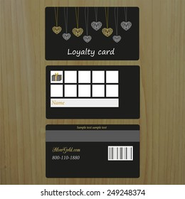 Black loyalty card on wood background. Place for your text.