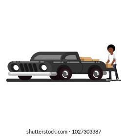 Black man loads boxes