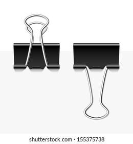Black metal binder clips. Vector.