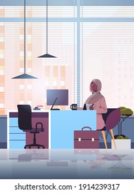 black muslim businesswoman sitting at workplace and using computer arab businesswoman working in office vertical full length vector illustration