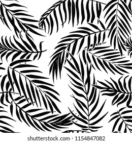 Black palm leaves on white background. Tropical silhouette. Seamless vector pattern.