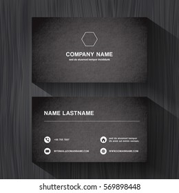 Black paper business namecard on a black wood background vector