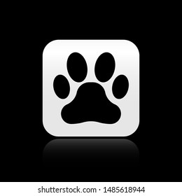 Black Paw print icon isolated on black background. Dog or cat paw print. Animal track. Silver square button. Vector Illustration