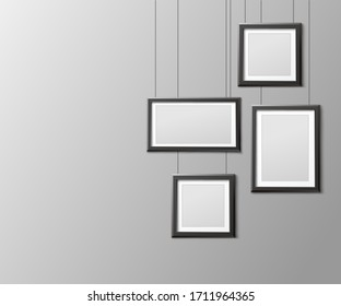 Black photo frame mockup set hanging from above on strings - blank photograph or picture collection design template. Realistic vector illustration.