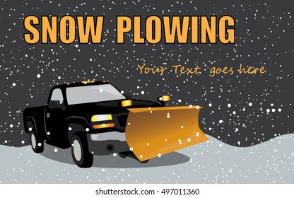 Black pick up truck with snow plow n a snow storm