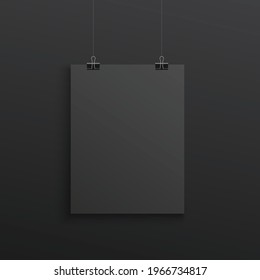 Black poster hanging with binder clips - realistic mockup on dark background. Blank A4 paper sheet with blank copy space - design display template, vector illustration