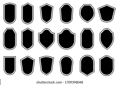 Black shields of various shapes without inscriptions. Vector illustration. Stock Photo.