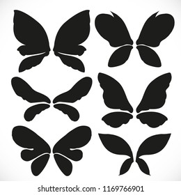 Black silhouette of fairy wings different form for cutting set 4 isolated on a white background