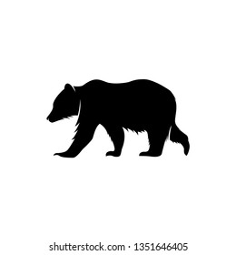 black silhouette in the form of a bear or a simple black bear.