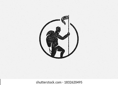 Black silhouette hiker putting flag on top mountain trip in highlands hand drawn stamp effect vector illustration. Vintage grunge texture on old paper for poster or label decoration.