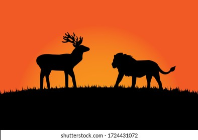 The black silhouette of a lion encounters a moose on a grassy hill with an orange background.